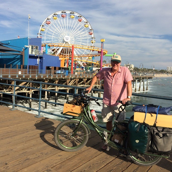 Man with Pedego electric bicycle on Santa Monica pier