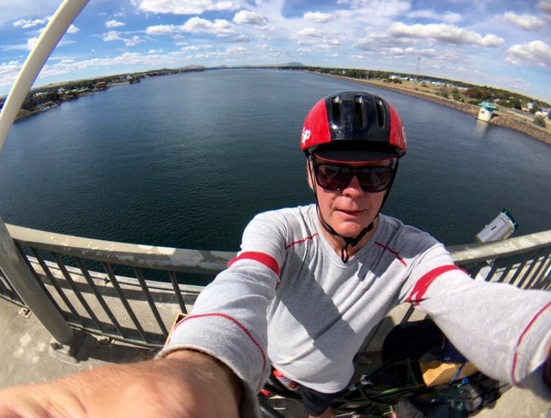 selfie of man riding pedego electric bicycle over Columbia River