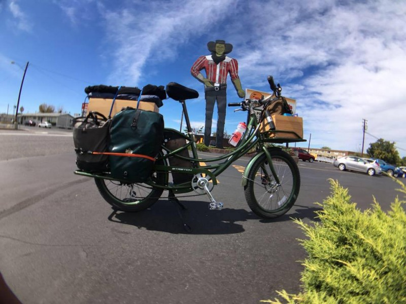 large statue in oregon beside pedego electric bicycle