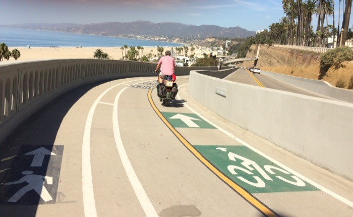 man rides pedego electric bike on santa monica bike path